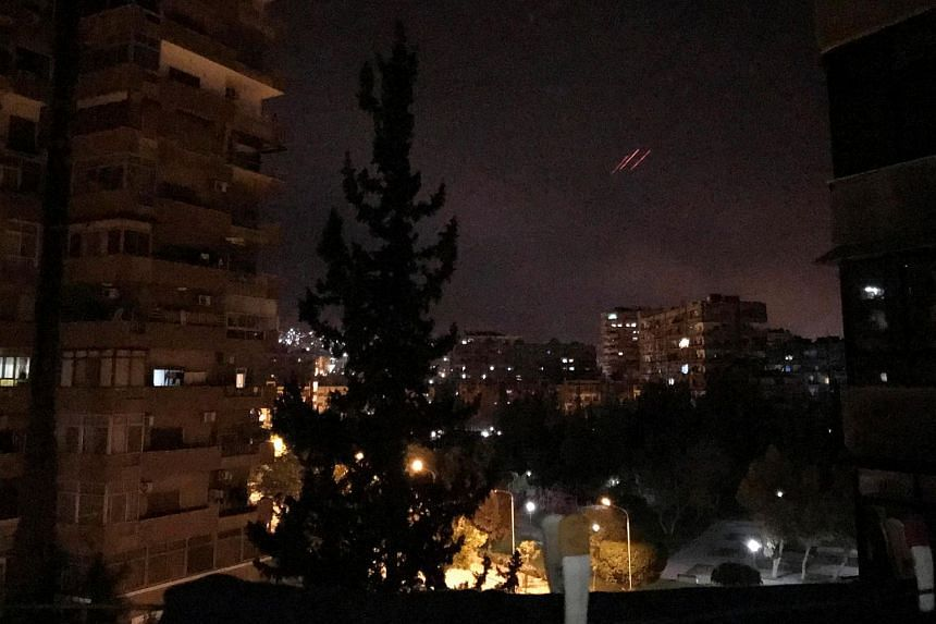 Anti-aircraft fire is seen over Damascus, Syria early April 14, 2018.