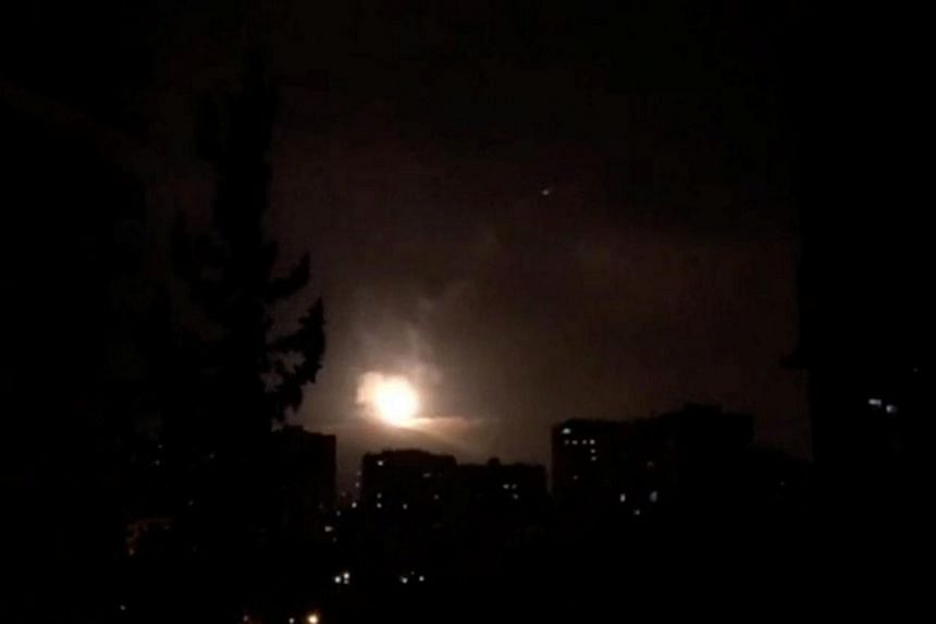 Syria air defences strike back after air strikes by US, British and French forces in Damascus, Syria in this still image obtained from video dated early April 14, 2018.