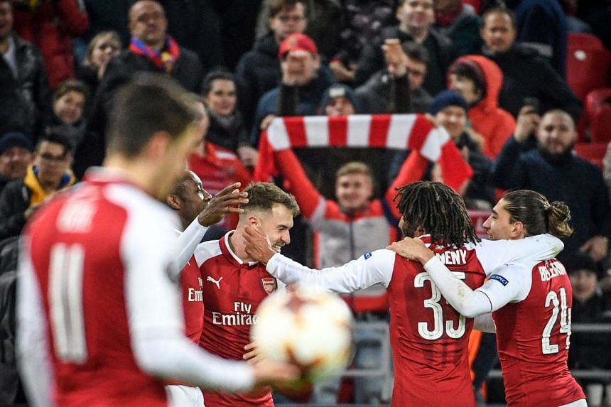 Arsenal players celebrate a goal against CSKA Moscow in the Europa League.