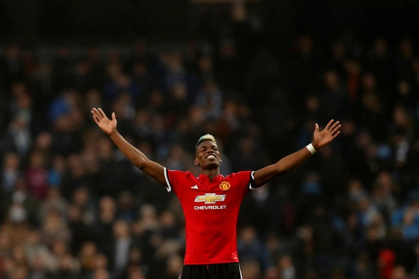 Pogba celebrating United's win over Manchester City on April 7, 2018.