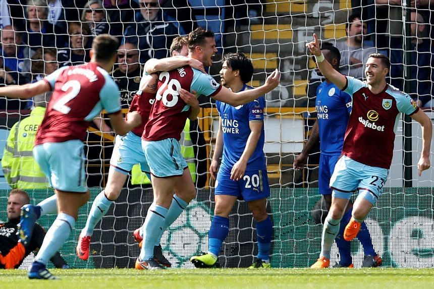Burnley's Kevin Long celebrates scoring their second goal with team mates.