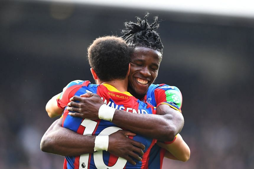 Crystal Palace's Wilfried Zaha and Andros Townsend celebrate after the match.