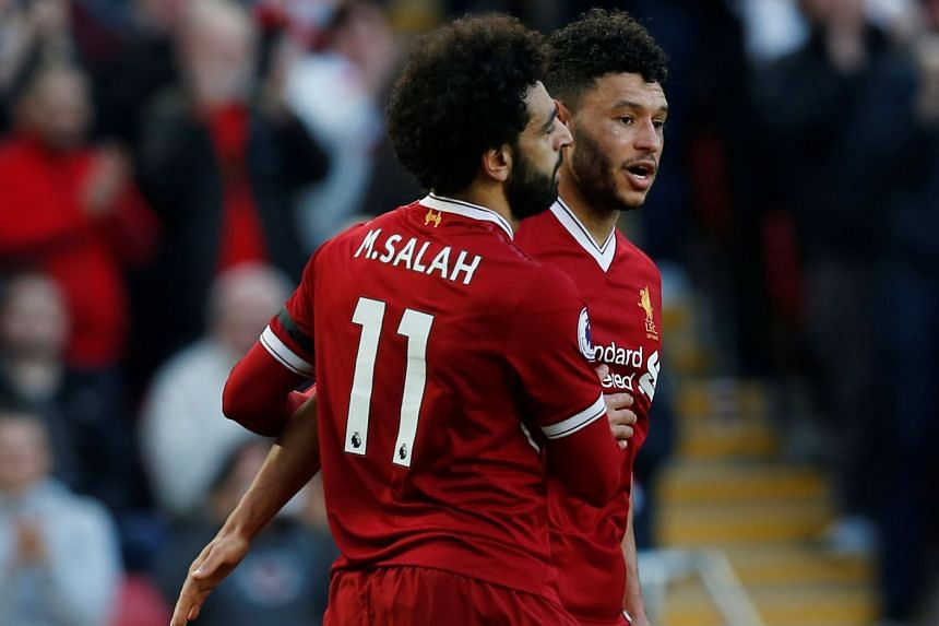 Salah celebrates scoring Liverpool's second goal with Alex Oxlade-Chamberlain.
