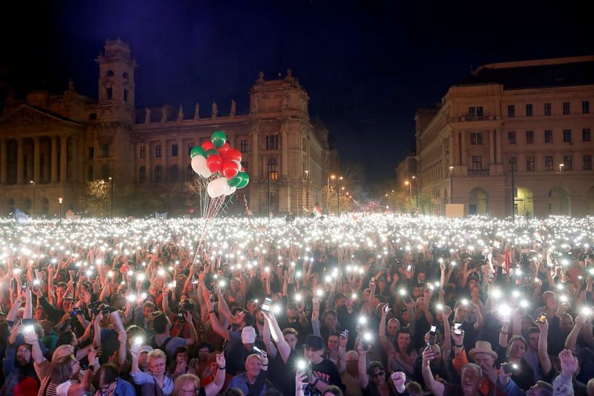 People attend a protest against the government of Prime Minister Viktor Orban in Budapest.
