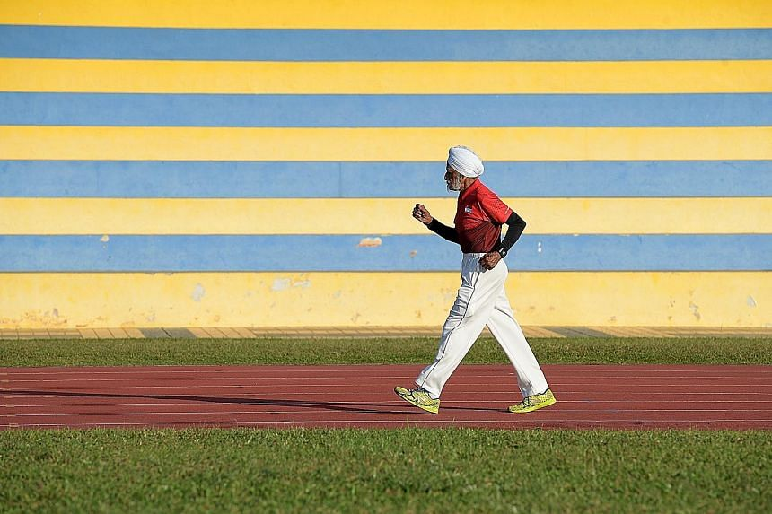 Mr Ajit Singh Gill training at Yio Chu Kang Stadium. He has represented Singapore in hockey, cricket and golf, and at the 1956 Melbourne Olympics. Now, he has taken up race walking and has won gold five times in regional events.