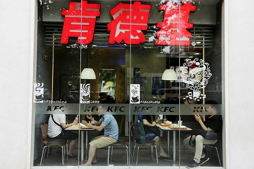 Customers having lunch at a KFC restaurant in Beijing. The chain was among those targeted by calls for a boycott, but analyst Ben Cavender say surveys show service brands that employ mostly Chinese citizens are viewed more positively.