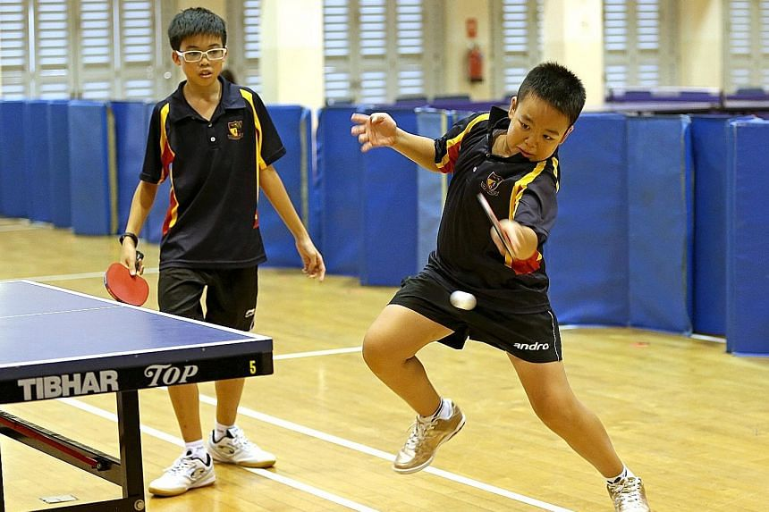 Ryan Chong returning a tough shot as Seth Wong looked on during the team's win over Kuo Chuan in the South Zone C Division third-place play-off in February.