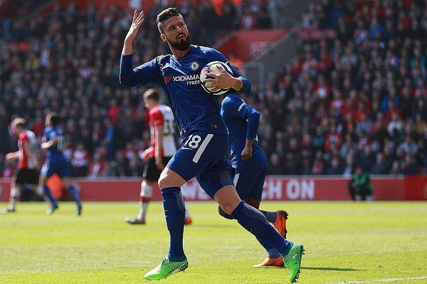 Chelsea forward Olivier Giroud rousing the away fans after coming off the bench to score his side's first goal against Southampton yesterday. Both sides meet again in next Sunday's FA Cup semi-final at Wembley.