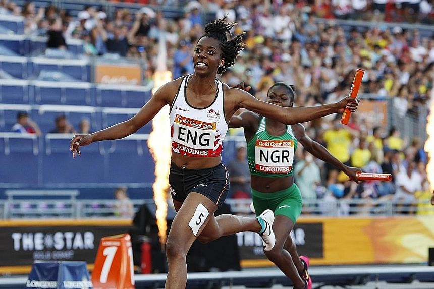 Lorraine Ugen anchoring England to the 4x100m gold, ahead of Nigeria's Rosemary Chukwuma.