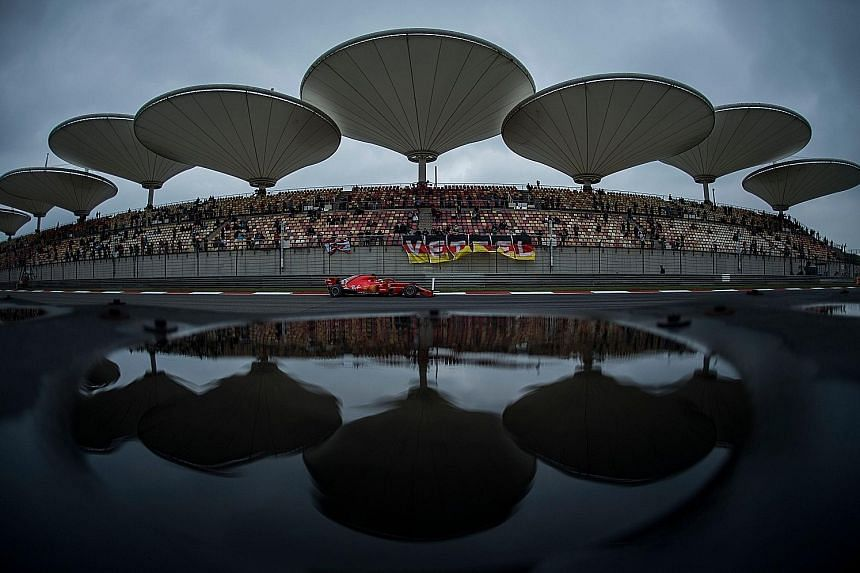 Ferrari's Sebastian Vettel driving on the straight during a practice session for the Chinese Grand Prix in Shanghai yesterday. Mercedes' Lewis Hamilton says the Ferraris are too fast on the straight.