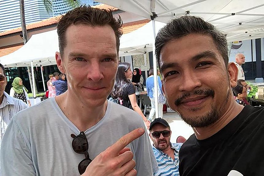 Avengers: Infinity War star Benedict Cumberbatch posing for a photo at Pasar Ugi, a marketplace celebrating Bugis culture as part of the Singapore Heritage Festival, yesterday.