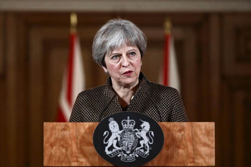 British Prime Minister Theresa May gives a press conference at Downing Street in central London, following British military action against Syria on April 14, 2018.