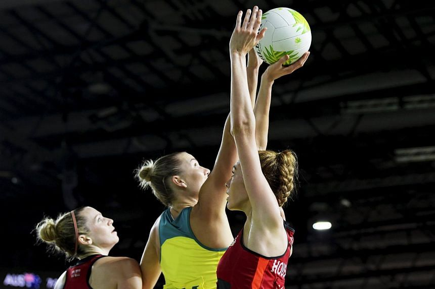 Courtney Bruce of Australia (centre) tries to block Helen Housby (right) of England during the Netball Gold Medal match between Australia and England at the Commonwealth Games in Gold Coast, Australia on April 15, 2018.