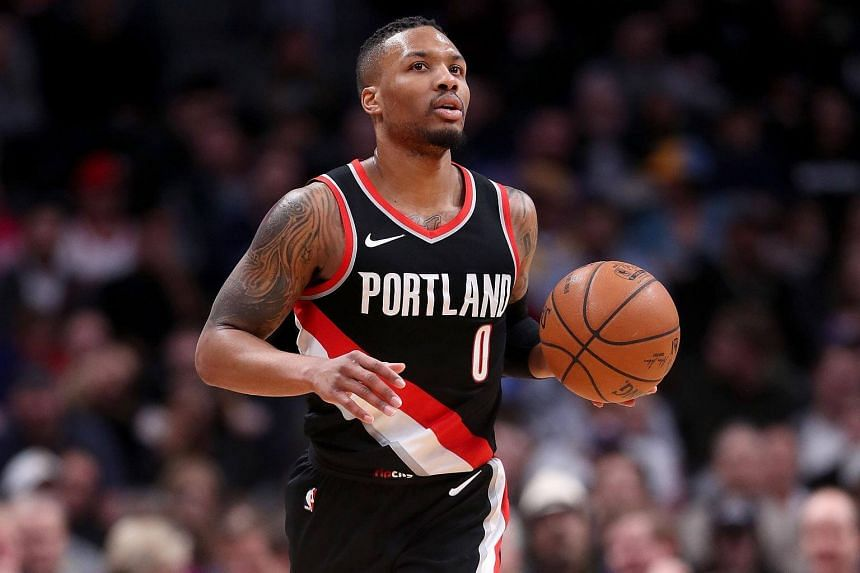 Damian Lillard of the Portland Trail Blazers brings the ball down the court against the Denver Nuggets at the Pepsi Center in Denver, on Jan 22, 2018.