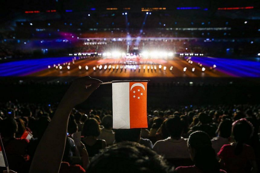 A spectator with a miniature Singapore flag during the opening ceremony of the 28th SEA Games held in Singapore from 5 to 16 June 2015.