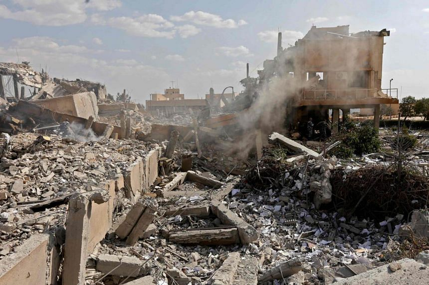 The wreckage of a building described as part of the Scientific Studies and Research Centre compound in the Barzeh district, north of Damascus, during a press tour on April 14, 2018.