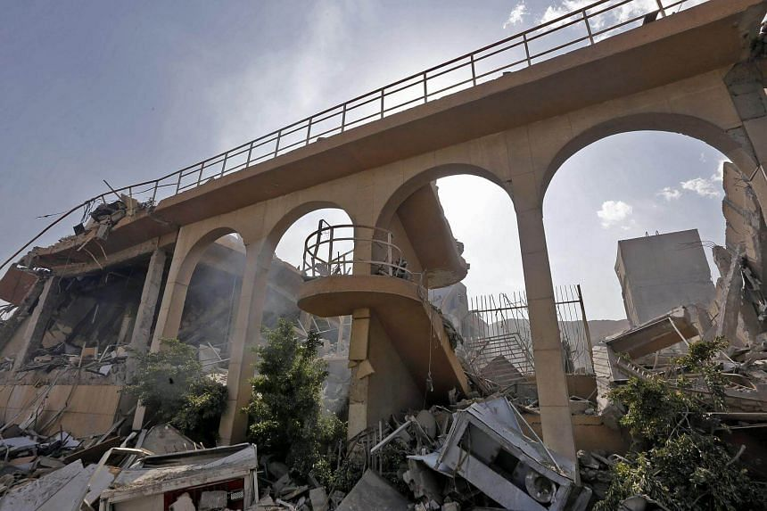 The wreckage of a building described as part of the Scientific Studies and Research Centre compound in Syria's Barzeh district. The US, Britain and France launched strikes against Syrian President Bashar al-Assad's regime in response to an alleged ch