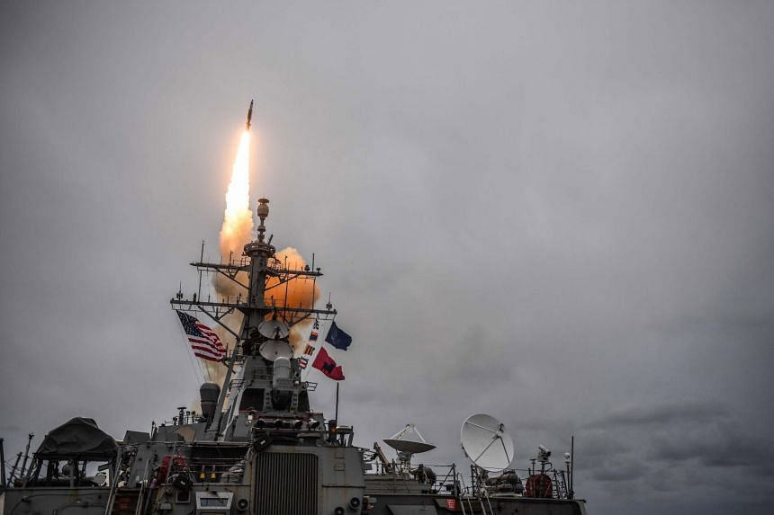 The Arleigh Burke-class guided-missile destroyer USS Donald Cook firing a standard missile 3 during an exercise at sea.