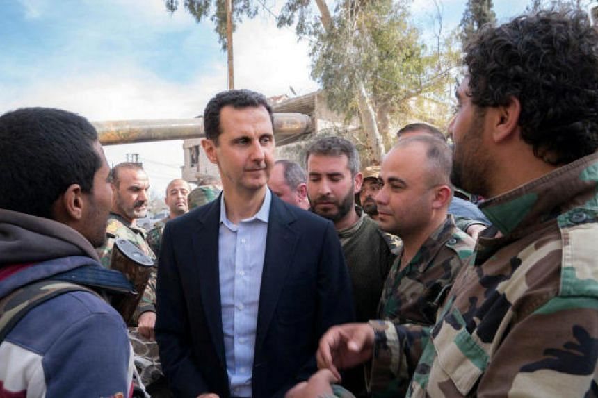 Syrian President Bashar al-Assad speaking with government soldiers in eastern Ghouta on March 18, 2018.