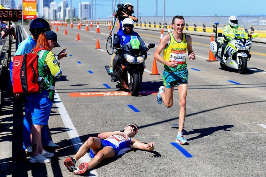 Scotland's Callum Hawkins lying on the ground after collapsing while running during the men's marathon final at the Commonwealth Games, on the Gold Coast, on April 15, 2018.