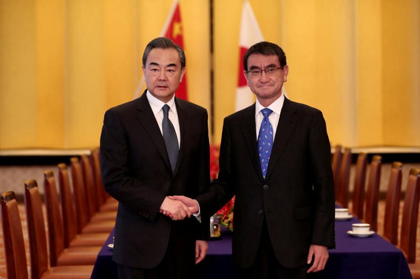 Chinese Foreign Minister Wang Yi (left) meeting Japanese counterpart Taro Kono in Tokyo on April 15, 2018.