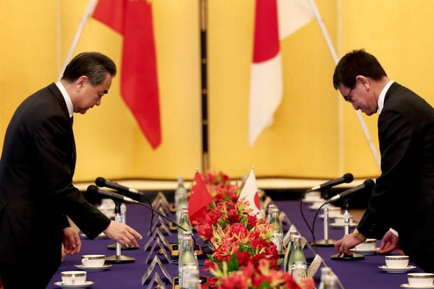 Chinese Foreign Minister Wang Yi (left) and Japanese counterpart Taro Kono meeting in Tokyo on April 15, 2018.