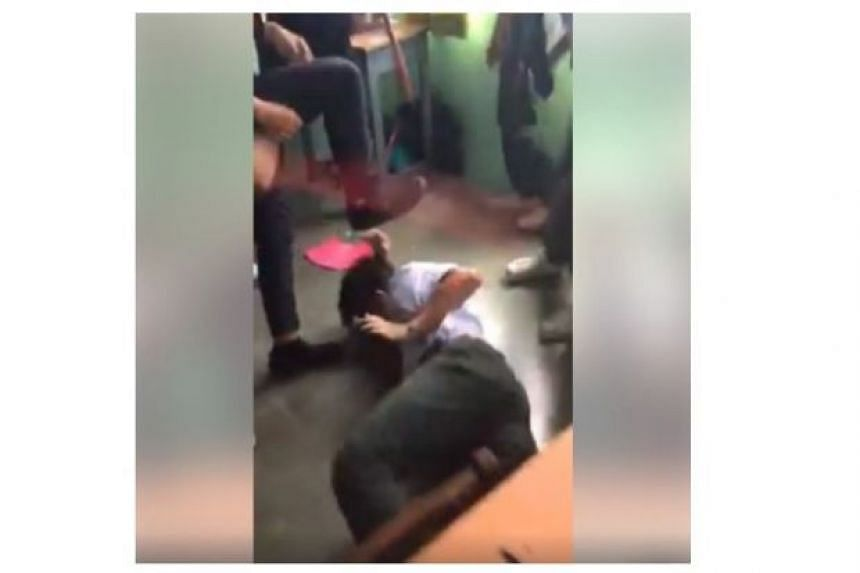 Malaysia's Education Ministry said it is investigating a video that showed eight male students assaulting another student with a broom.