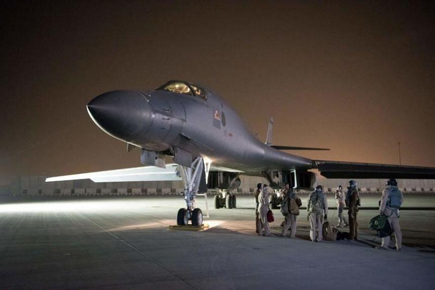 US Air Force personnel conducting pre-flight checks on a B-1B Lancer bomber at Al Udeid Air Base, Qatar, on April 13, 2018.