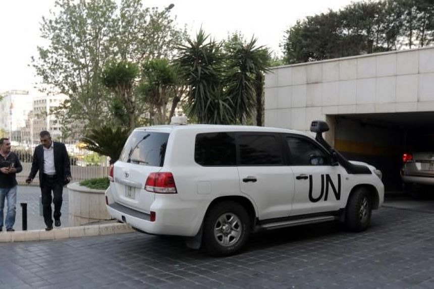 UN vehicles carrying a team from the Organisation for the Prohibition of Chemical Weapons arriving at the Four Seasons hotel in Damascus on April 14, 2018.