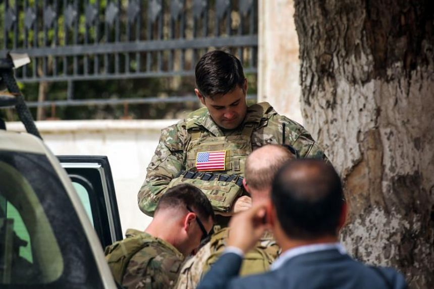 US soldiers in the YPG-held Syrian city of Manbij, where the US military has a presence, on March 22, 2018.