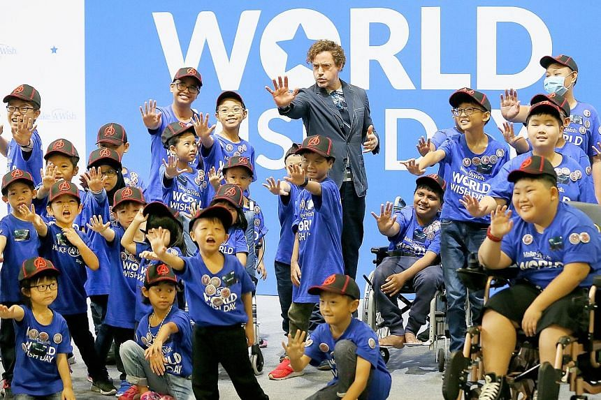 "Iron Man actor Robert Downey Jr yesterday brought cheer to 37 children, leading them in a pledge that turned them into ""little superheroes"". The 37 children, all battling critical illnesses, are beneficiaries of Make-A-Wish Foundation. They were play"