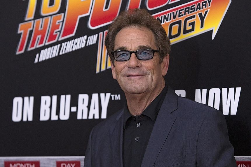 Singer Huey Lewis (right) said doctors believe he may be suffering from Meniere's disease, an inner-ear disorder that causes vertigo, ringing in the ear and permanent hearing loss.