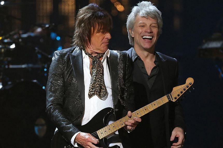 Bon Jovi's guitarist Richie Sambora and singer Jon Bon Jovi (both left) on stage at the Rock and Roll Hall of Fame induction ceremony last Saturday. Mr Sam Waymon (above), younger brother of the late singer-songwriter Nina Simone who was inducted pos