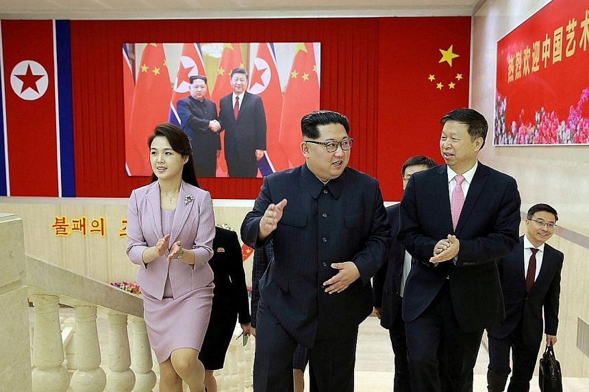 North Korean leader Kim Jong Un (centre) and his wife Ri Sol Ju meeting Mr Song Tao, the head of the Chinese Communist Party Central Committee's international department, in Pyongyang last Saturday. Mr Song was leading an art troupe to a spring festi