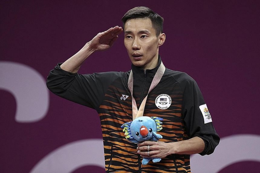 Gold medallist Lee Chong Wei saluting during the Malaysian anthem at yesterday's medal ceremony. Having never won the Olympic gold, he says he may still give it a shot at the 2020 Tokyo Games, when he will be almost 38.