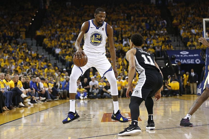 Golden State Warriors forward Kevin Durant (35) takes on San Antonio Spurs guard Bryn Forbes in the first round of the play-offs. The Warriors routed their opponents 113-92.