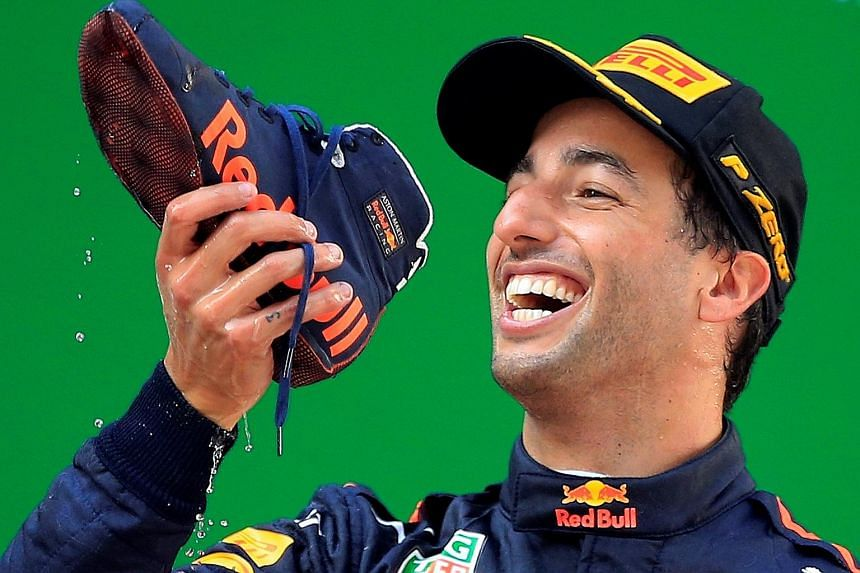Red Bull's Australian driver Daniel Ricciardo doing a 'shoey' - drinking champagne from a shoe - as he celebrates his victory in the Chinese Grand Prix in Shanghai yesterday.