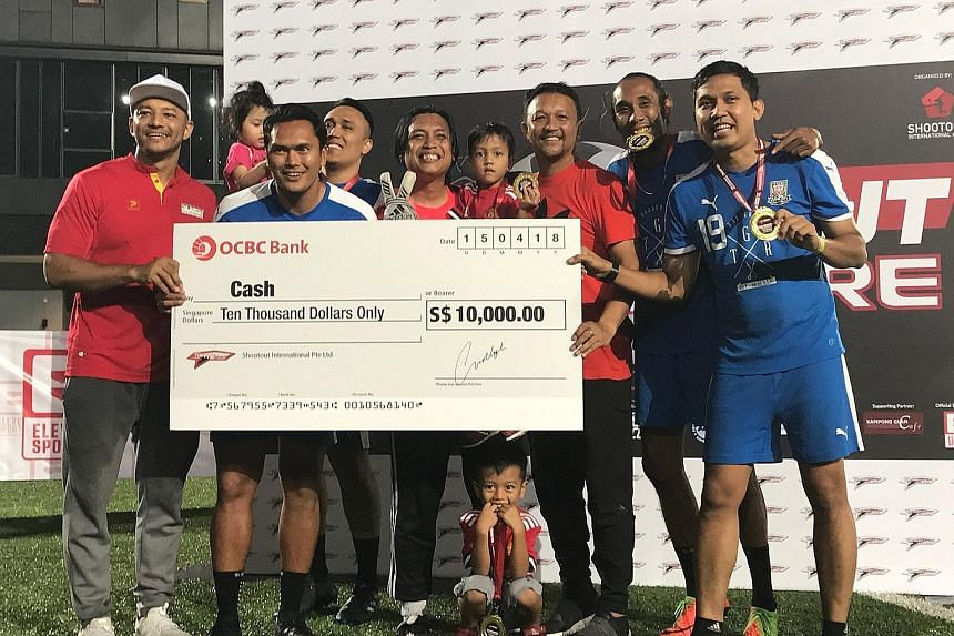 The Shootout organiser, Imran Abdul Rahman (left) and Fandi Ahmad handing the $10,000 winners' cheque to former Singapore international Tengku Mushadad (third from left) and his team, named 8ighty 4our. The 33-year-old and 8ighty 4our were the last t