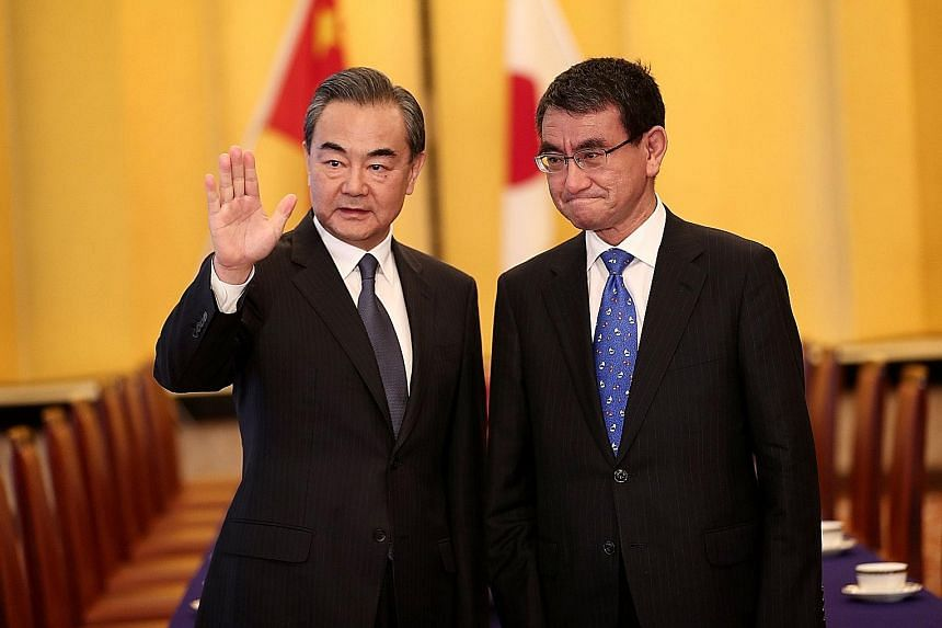 Japan's Mr Taro Kono (right) and China's Mr Wang Yi reiterated yesterday that bilateral ties were at a crucial turning point.