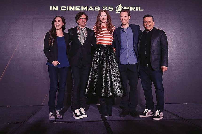 In Singapore to promote their new Marvel movie, Avengers: Infinity War, are (from far left) executive producer Trinh Tran, cast members Robert Downey Jr, Karen Gillan and Benedict Cumberbatch, and director Joe Russo.