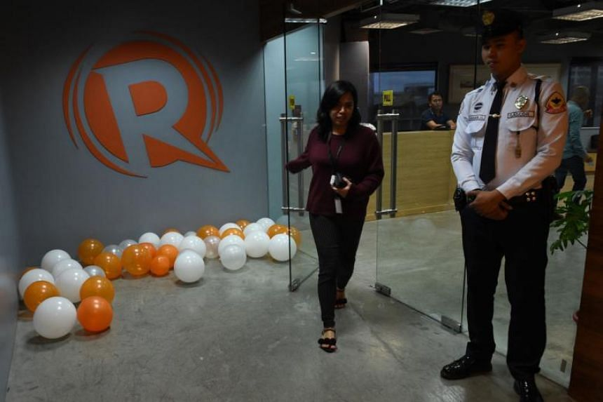An employee of online portal Rappler at the site's editorial office in Manila, Philippines.
