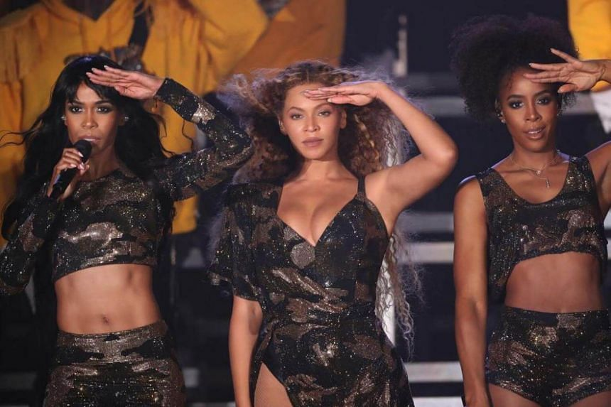 Fellow Destiny's Child members Kelly Rowland (right) and Michelle Williams joined Beyonce for three Destiny's Child songs.