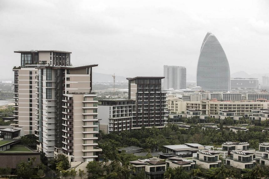 Buildings stand in Sanya, Hainan province, China, on March 14, 2018.