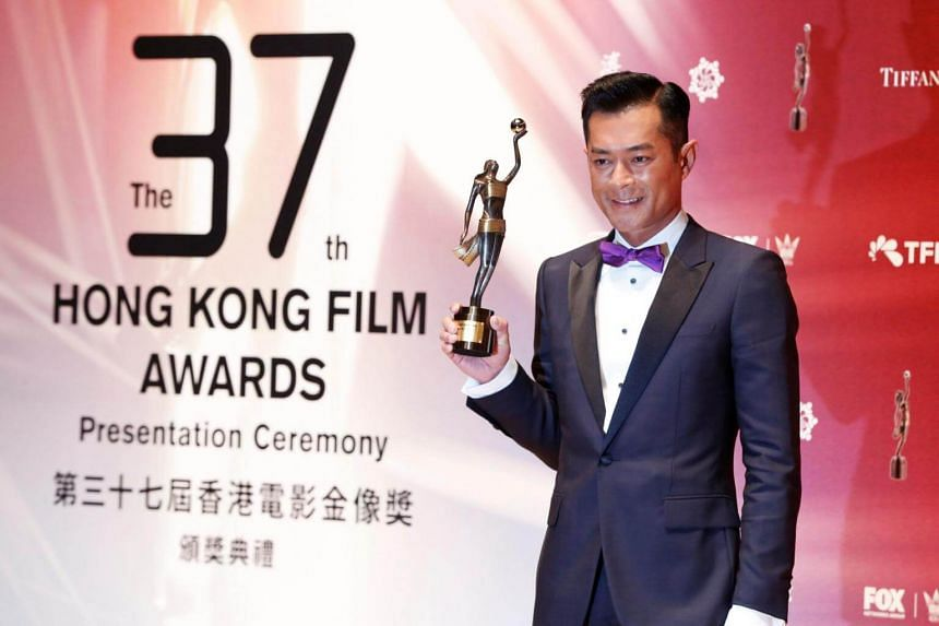 Hong Kong actor Louis Koo posing with his trophy for the Best Actor award at the 37th Hong Kong Film Awards on April 15, 2018.