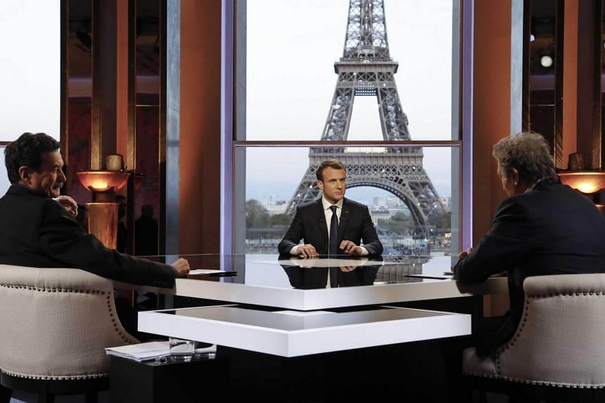 French President Emmanuel Macron (centre) sitting with journalists at the Theatre National de Chaillot near the Eiffel Tower in Paris, France, on April 15, 2018.