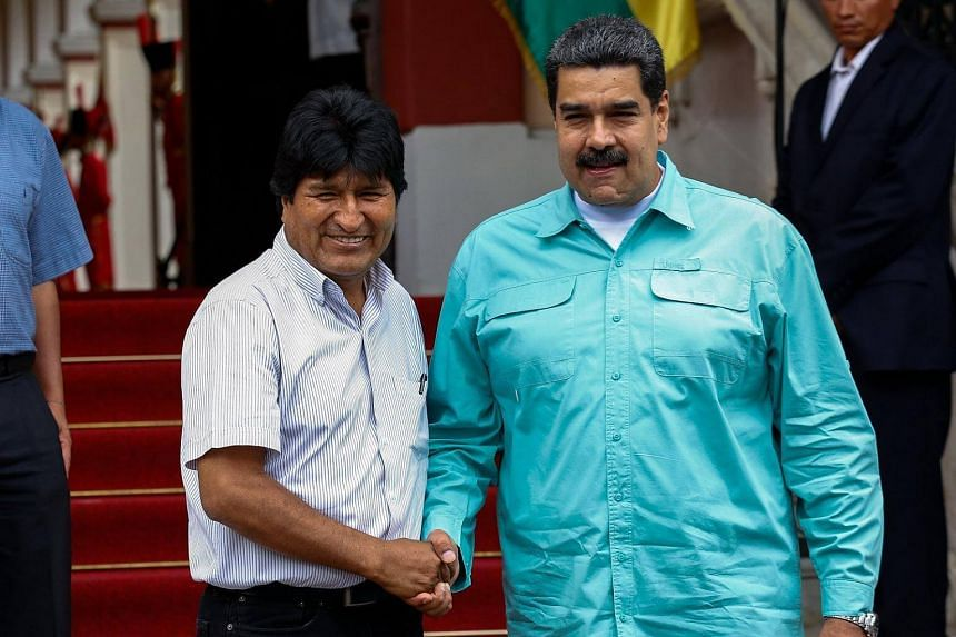 Venezuelan President Nicolas Maduro (right) shaking hands with his Bolivian counterpart Evo Morales during a meeting at the Miraflores Presidential Palace in Caracas, Venezuela, on April 15, 2018.