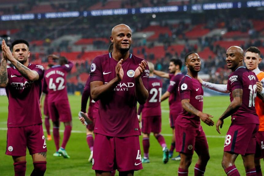Manchester City's Vincent Kompany and teammates applaud the fans after their match against Tottenham Hotspur at Wembley Stadium in London, on April 14, 2018.