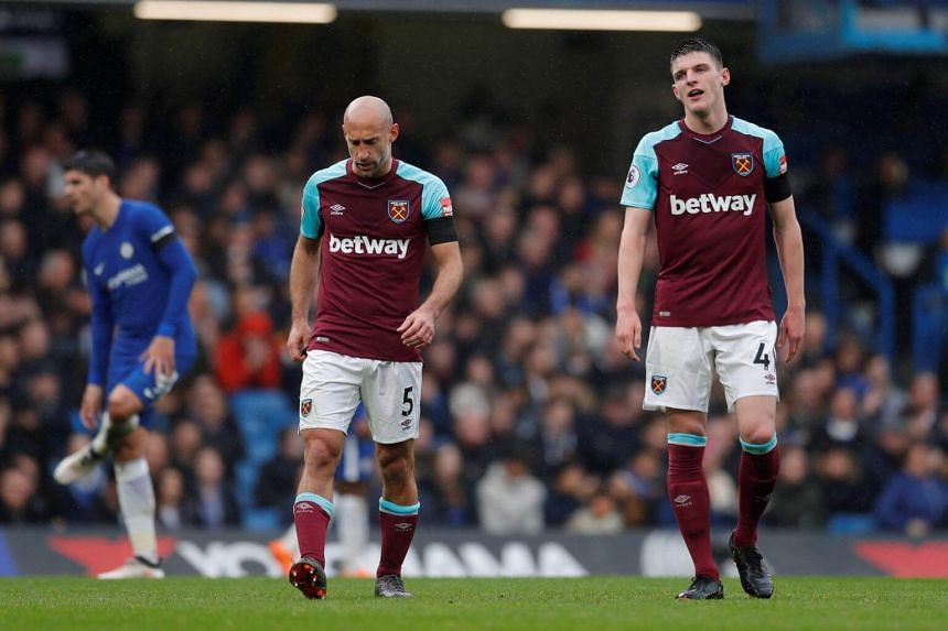 West Ham United's Pablo Zabaleta and Declan Rice looks dejected after their match against Chelsea, on April 8, 2018.