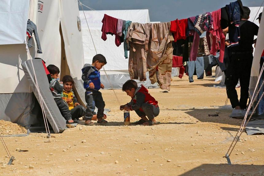Syrian children play at a camp for displaced Syrians in al-Bil, Syria on April 13, 2018.