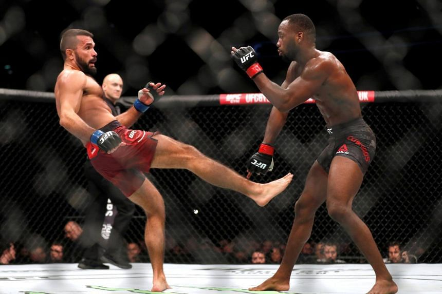 """Leon """"Rocky"""" Edwards (right) in action with Peter Sobotta at the UFC fight night in London on March 17, 2018."""